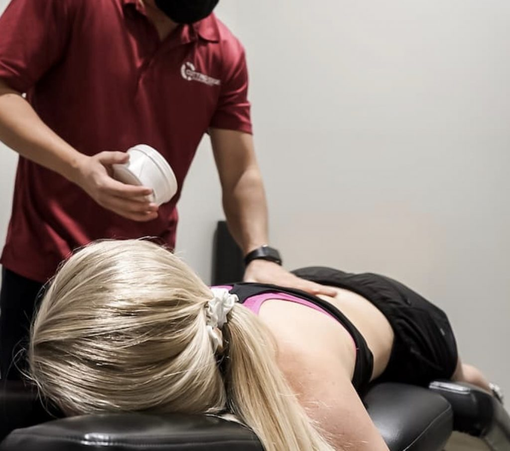 athlete getting chiropractic treatment